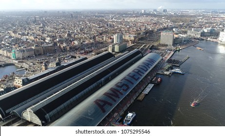 Aerial photo Amsterdam Centraal the largest railway station of Amsterdam Netherlands and major national railway hub and the most visited national heritage site of Holland