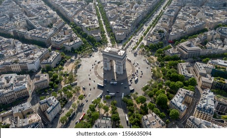Aerial photo of the Arc de Trioumphe in Paris, France. Photo taken early morning, Champs Elysees leads from the Arc to the top right corner of the photo.