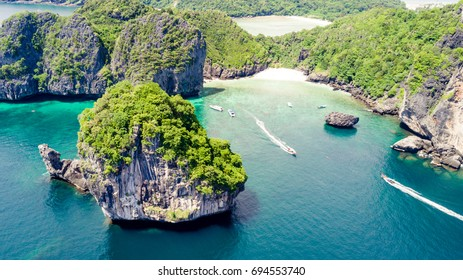 Aerial photo from a bay with boat around big rocks