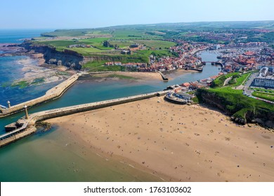 Aerial photo of the beautiful town of Whitby in the UK, North Yorkshire in the UK showing the beach front and the village centre and harbour