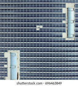 Aerial photo of a big hall badger with solar modules, detailed view from the bird's-eye view