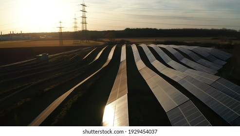 aerial photo of big solar power plant during sunset in the middle of nature sustainable renewable energy