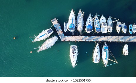 Aerial photo of boats docked in tropical port