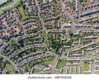 Aerial photo of the British town of Middleton in Leeds West Yorkshire showing typical suburban housing estates with rows of houses, taken on a bright sunny day using a drone.