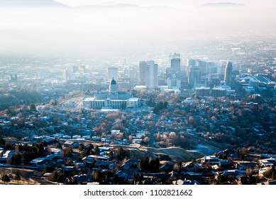 Aerial photo of Building of Utah State Capitol in Salt Lake City with downtown on the background