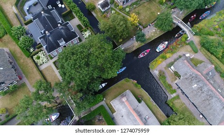 Aerial photo of busy canal in Giethoorn is town in province of Overijssel Holland and is often referred to as the Venice of the Netherlands because of the popular canals with tourist tour boats