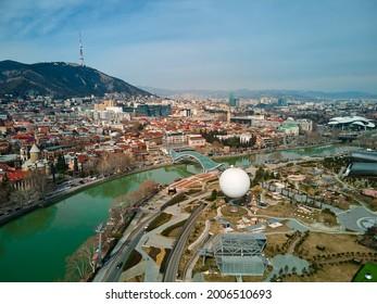 aerial photo. City landscape of Tbilisi and the Kura river. Tbilisi, Georgia - 03.17.2021