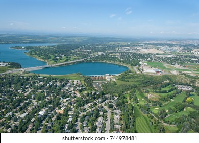 Aerial photo of a city and man made reservoir during summer. Glenmore reservoir, Calgary, Alberta, Canada.
