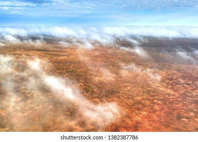 Aerial photo of clouds above the Australian bush