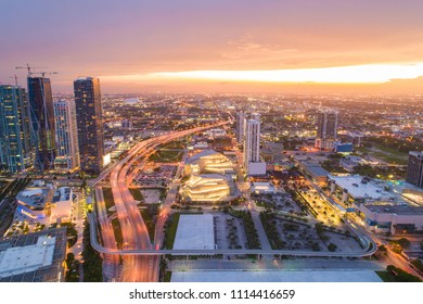 Aerial photo Downtown Miami with beautiful sunset at twilight and city lights