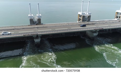 Aerial photo of Eastern Scheldt storm surge barrier Oosterscheldekering showing traffic driving over largest of 13 ambitious Delta Works series of dams and storm surge barriers in Zeeland Netherlands