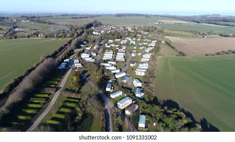 Aerial photo of Farm Campsite and Holiday Park showing the long-term campsite that includes permanent and semi-permanent setups also showing recreational vehicles RVs below