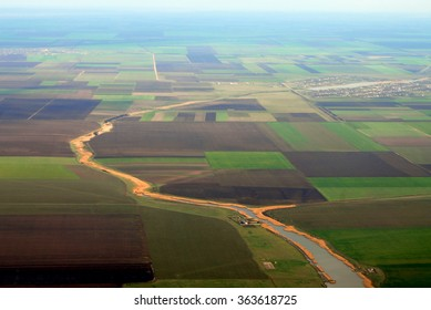 Aerial photo of Farmland and little river