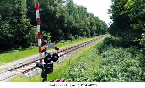 Aerial photo of grade crossing signal forest railway in background railroad also known as the permanent way it enables trains to move by providing dependable surface for their wheels to roll upon