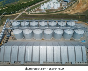 Aerial photo of a grain terminal with a closed warehouse and silos
