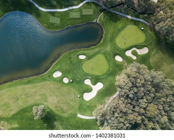 Aerial photo of green golf fields in spring
