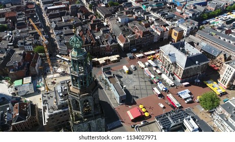 Aerial photo Grote Markt and Martinitoren highest church steeple in city of Groningen Netherlands and bell tower of Martinikerk located at north-eastern corner of Grote Markt Main Market Square