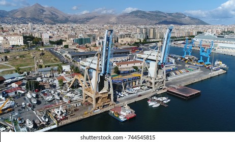 Aerial photo of harbor cranes located in Port of Palermo in Italian Porto di Palermo port serving Palermo Sicily Italy is one of major ports for passenger traffic in Mediterranean