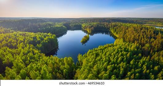 Aerial photo of heart-shaped lake in National park Narachanski (Belarus)