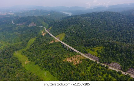 Aerial photo of a highway going through the forest