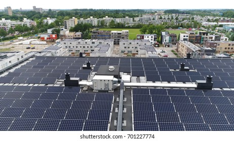 Aerial photo housing project development project showing modern roof filled with solar panels proving sustainable energy or renewable energy by sunlight 4k