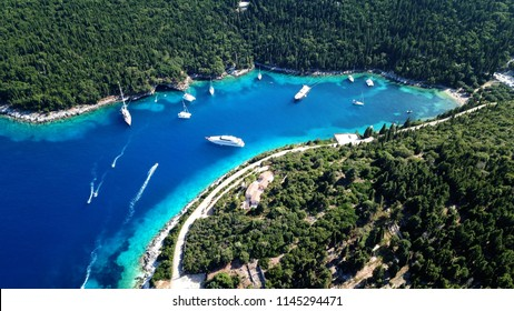 Aerial photo from iconic traditional fishing village and bay of Fiskardo with beautiful houses and Ionian architecture, Cefalonia island, Greece