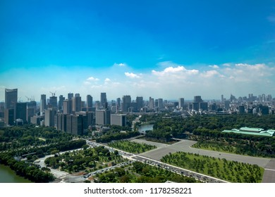 An aerial photo of the Imperial Palace, buildings and the Houses of Parliament with blue sky, Tokyo, Japan.