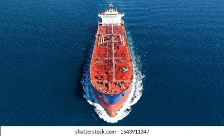 Aerial photo of industrial oil and fuel tanker cruising deep blue Mediterranean sea