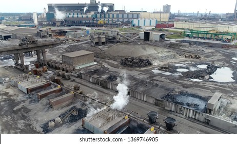 Aerial photo of industrial railway station distribution point with train karts loaded with slag pots for the transportation of crude iron located at steelmaking factory producing steel from or