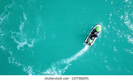 Aerial photo from jet ski cruising in low speed near port of Mykonos island, Cyclades, Greece