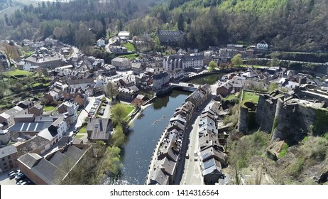 Aerial photo of La Roche en Ardenne and in background two people in kayak moving over Ourth river located in Belgium this town is one of most popular tourist destinations in Ardennes