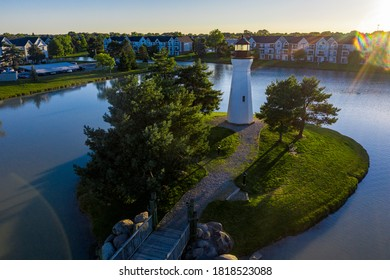 Aerial photo of a lighthouse on a manmade island. Picture taken right before dusk in Macomb, MI.
