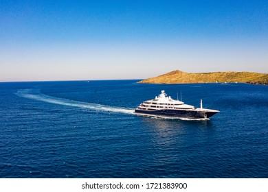 Aerial photo of luxury mega yacht on marina or sea