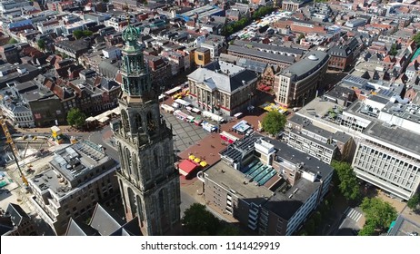 Aerial photo of the Martinitoren also called the St. Martin's Tower is highest church steeple in city of Groningen Netherlands and the bell tower of the Martinikerk als showing Grote Markt