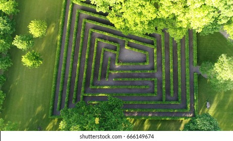Aerial photo medium altitude above bush maze showing different paths just one leading to exit also known as labyrinth is path or collection of paths typically from entrance to goal drone top-down view