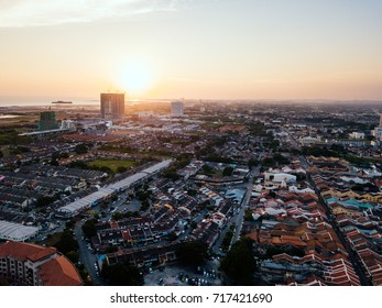 Aerial photo of Melaka City in Malaysia during sunset facing Strait of Malacca