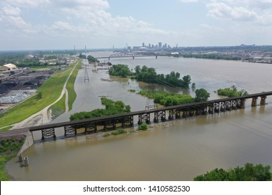 Aerial photo of the Mississippi River at St Louis where flood waters are near the top of the levee