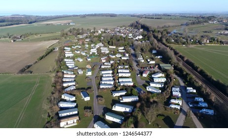 Aerial photo of mobile homes partlty used as permanent houses but aslo for holiday or temporary accommodation they are left often permanently or semi-permanently in one place but can be moved