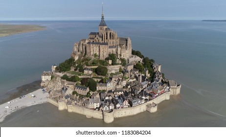 Aerial photo of Mont Saint-Michel a town located in Normandy west of Paris it consists of an abbey and monastery on top and below great halls then stores and housing on the side of the fortification