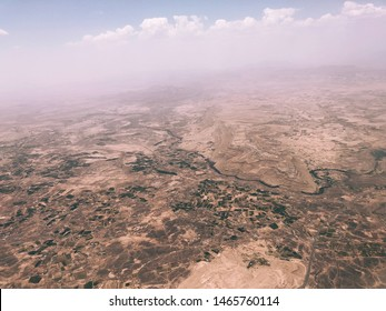 aerial photo of mountains landscape and mountains of Sanaa yeman with a river running through the mountains