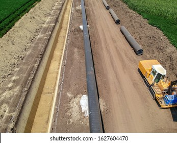 Aerial Photo of Natural Gas Pipeline Construction in Cultivated Agricultural Farm Field - Turkish Stream. Aerial Drone View of a Construction Site of the European Natural Gas Pipeline.
