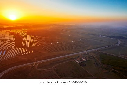 Aerial photo of new energy solar photovoltaic panels at sunrise
