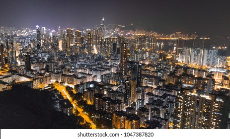 Aerial photo at night in Hong Kong featuring the famous night scene with lots of household light coming out from all the building blocks