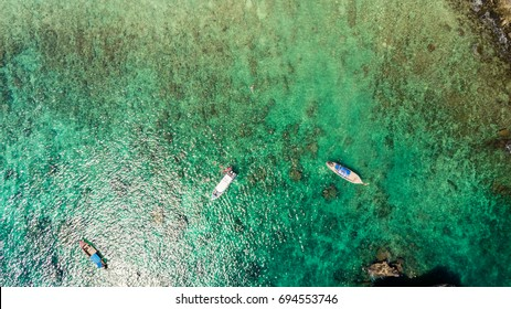 Aerial photo with ocean boat and snorkeling
