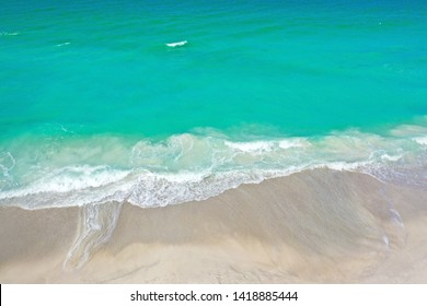 Aerial Photo of the Ocean Surf Coming in on the Beach of Anna Maria Island