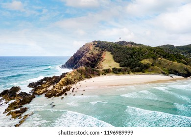 Aerial photo of the ocean and surfers at The Pass, Byron Bay, New South Wales, NSW, Australia.