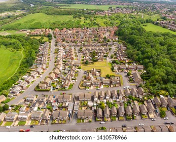 Aerial photo overlooking the British town of Castleford near Wakefield in West Yorkshire, rugby showing rows of houses and fields in the background, taken on a sunny bright summers day.