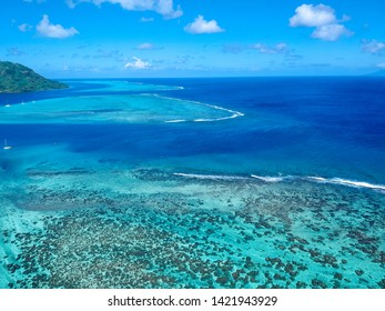 It is an aerial photo of the pass from Fare to Huahine in French Polynesia with a lagoon on the side.