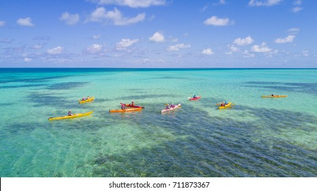 Aerial photo of people Kayaking at Glover's Reef Atoll in Belize