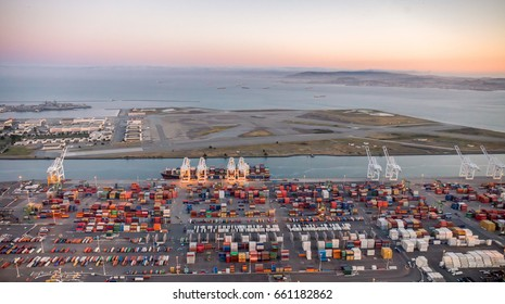 An aerial photo of the port of Oakland at dawn in Oakland, California